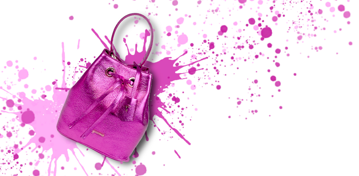 Fuchsia laminated leather bucket bag on a colored background
