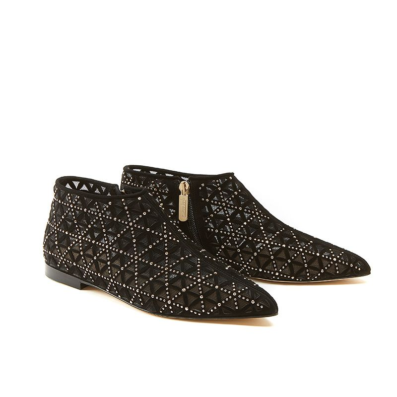 Black suede flat ankle boots with iconic laser cut pattern and small gold studs