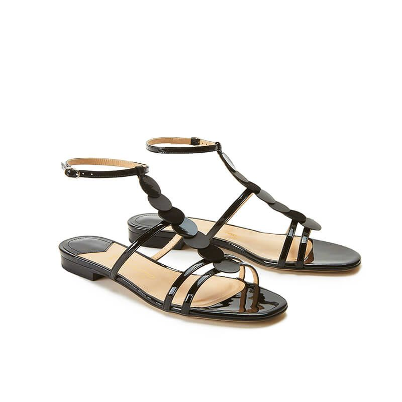 Black patent leather sandals with ankle strap and leather and suede discs, SS19 collection by Fragiacomo, side view