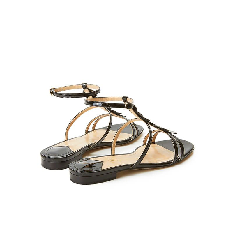 Black patent leather sandals with ankle strap and leather and suede discs, SS19 collection by Fragiacomo, back view