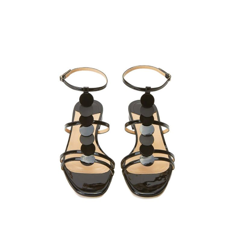 Black patent leather sandals with ankle strap and leather and suede discs, SS19 collection by Fragiacomo, over view