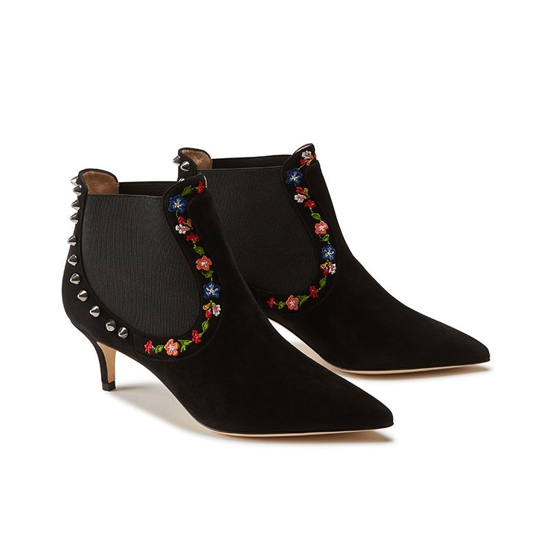 Black suede ankle boots hand made in Italy with studs and floral embroidery, women's model by Fragiacomo, side view