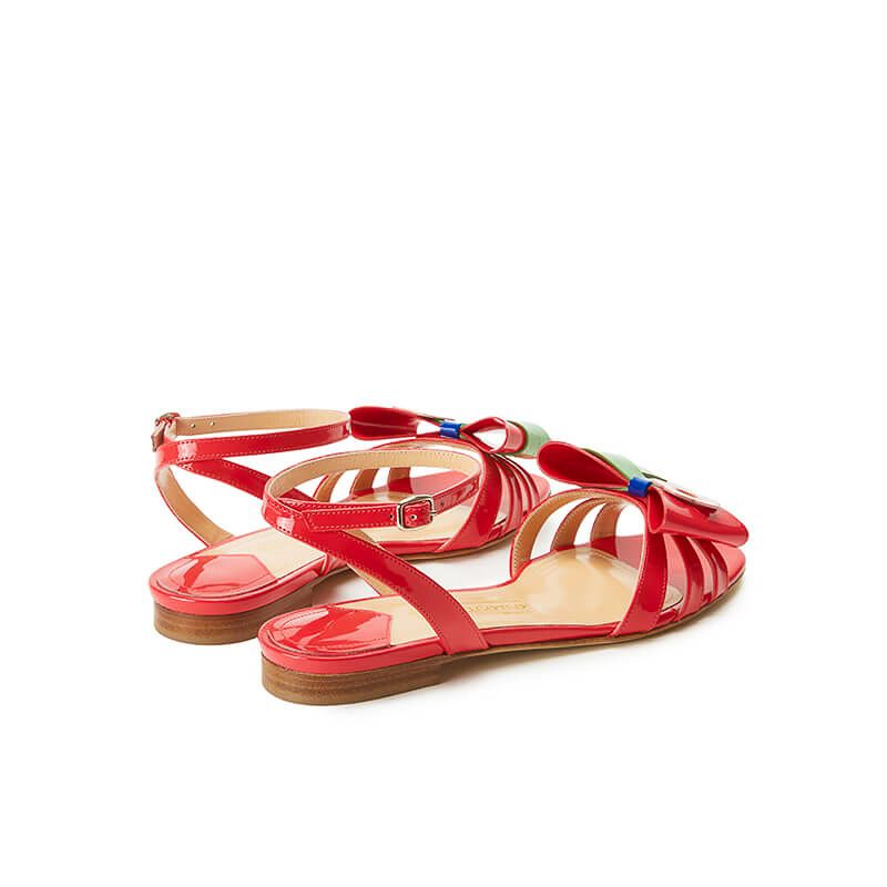 Coral red patent leather flat sandals with ankle strap and multicolor bow, SS19 collection by Fragiacomo, back view