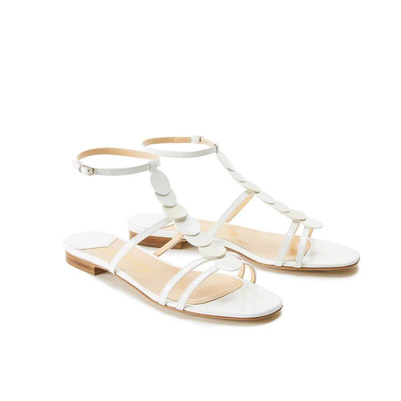 Sandali bianchi in vernice con cinturino e dischi in pelle di camoscio, collezione SS19 by Fragiacomo, vista laterale