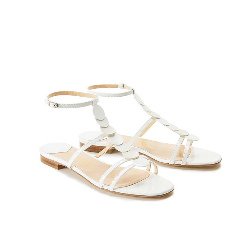 White patent leather sandals with ankle strap and leather and suede discs, SS19 collection by Fragiacomo, side view