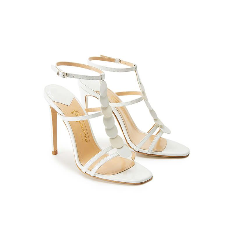 White patent leather sandals with ankle strap, leather discs and high heel 100mm, SS19 collection by Fragiacomo, side view
