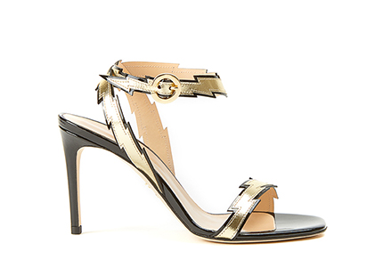 High-heeled sandals with elegant and seductive design, made of black patent leather and decorated with gold-colored straps in laminated leather in the shape of flash by Fragiacomo