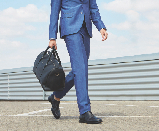 Man with travel bag in black moose leather and silver accessories by Fragiacomo