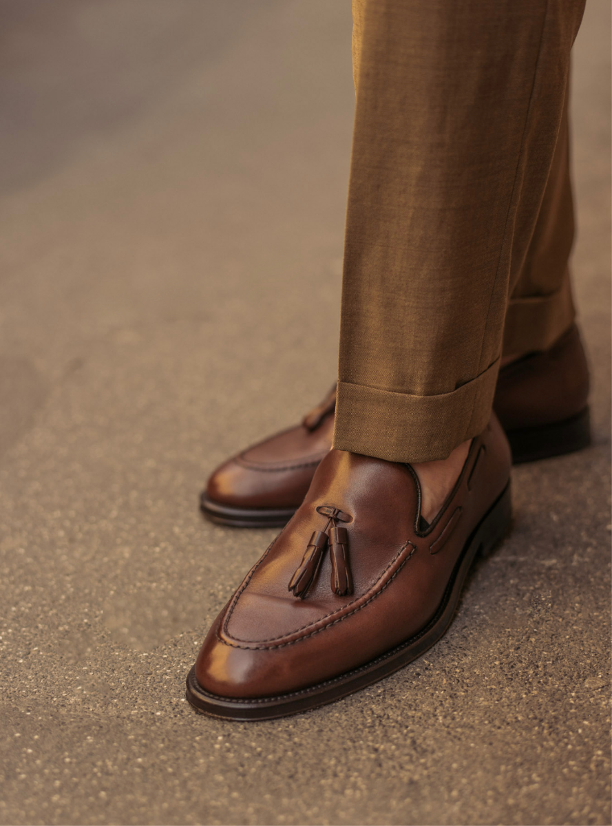 Light brown calfskin tassel loafers, hand made in Italy worn by a man, elegant by Fragiacomo